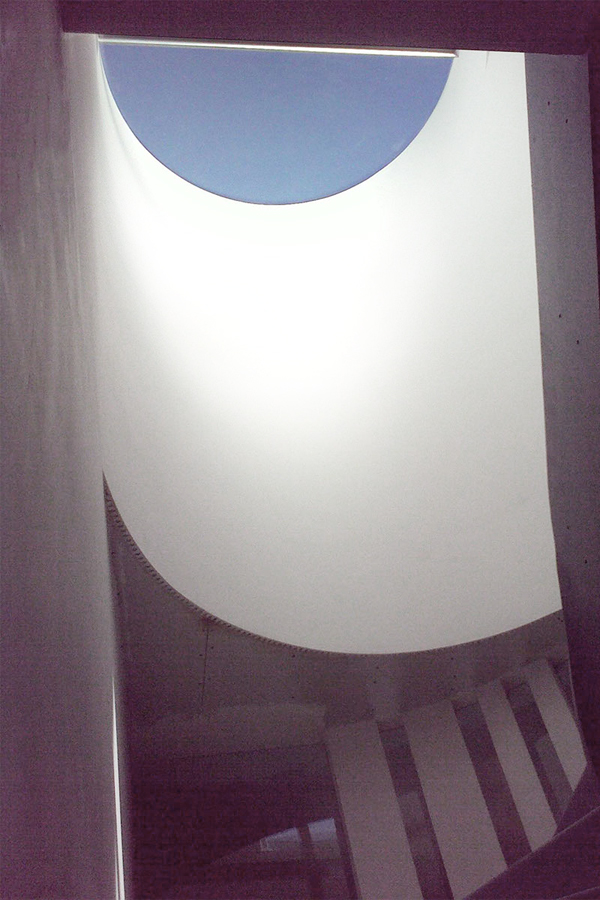 round rooflight lighting the staircase