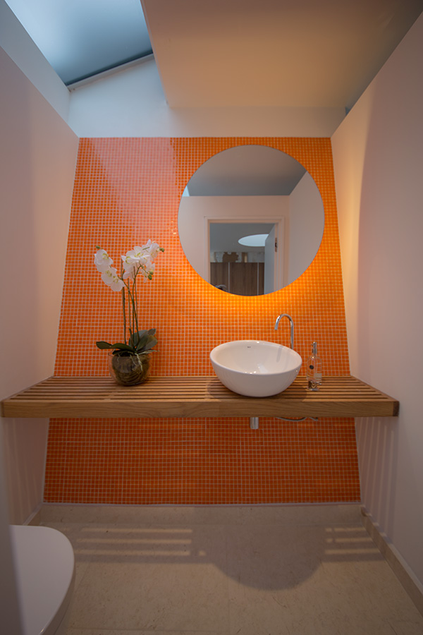 guest cloakroom orange mosaic with oak shelf